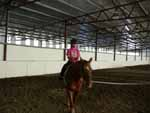 Our daughter at her weekly riding lesson